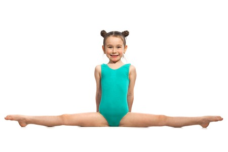 Photo pour Little girl gymnast sitting in the cross splits. Isolated on white background. Sport, active lifestyle concept - image libre de droit