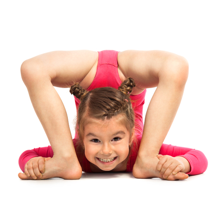 Photo pour Flexible little girl gymnast doing acrobatic feat, isolated on white background. Sport, active lifestyle concept - image libre de droit