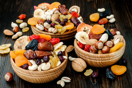 Photo for Mix of dried fruits and nuts on dark wood background. Symbols of judaic holiday Tu Bishvat - Royalty Free Image