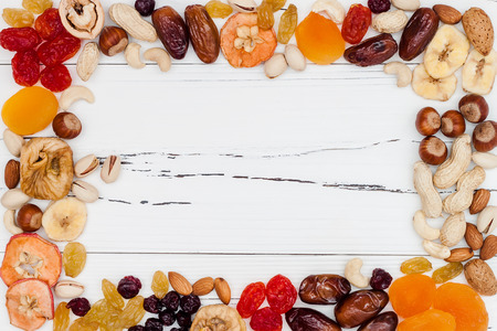 Photo for Mix of dried fruits and nuts on a white vintage wood background with copy space. Top view. Symbols of judaic holiday Tu Bishvat - Royalty Free Image