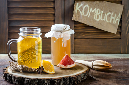 Photo for Homemade fermented raw kombucha tea with different flavorings. Healthy natural probiotic flavored drink. Copy space - Royalty Free Image