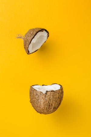Photo for Coconut on yellow colored background, minimal flat lay style - Royalty Free Image