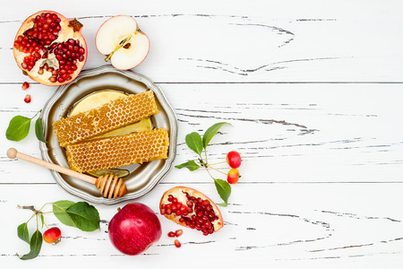 Photo for Apple, pomegranate and honey, traditional food of jewish New Year - Rosh Hashana. Copy space background - Royalty Free Image