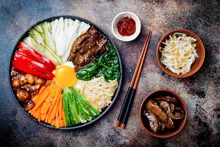 Photo for Bibimbap, traditional Korean dish, rice with vegetables and beef. Top view, overhead, flat lay - Royalty Free Image