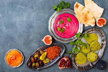 Foto de Middle Eastern traditional dinner. Authentic arab cuisine. Meze party food. Top view, flat lay, overhead, copy space - Imagen libre de derechos