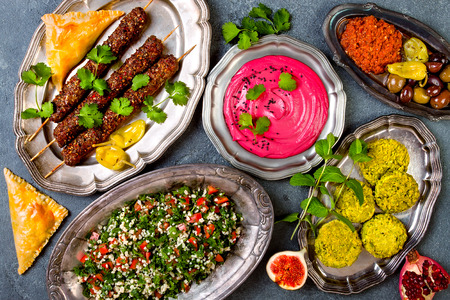 Photo for Middle Eastern traditional dinner. Authentic arab cuisine. Meze party food. Top view, flat lay, overhead  - Royalty Free Image