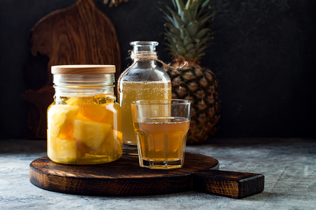 Foto de Fermented mexican pineapple Tepache. Homemade raw kombucha tea with pineapple. Healthy natural probiotic flavored drink. Copy space - Imagen libre de derechos