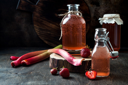Foto de Homemade fermented strawberry and rhubarb kombucha. Healthy natural probiotic flavored drink. Copy space - Imagen libre de derechos