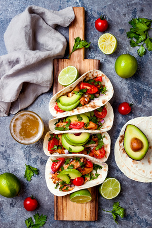Foto für Mexican grilled chicken tacos with avocado, tomato, onion on rustic stone table. Recipe for Cinco de Mayo party. Top view, overhead, flat lay. - Lizenzfreies Bild
