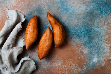 Photo for Sweet potato on rustic table. Cooking concept. Top view - Royalty Free Image