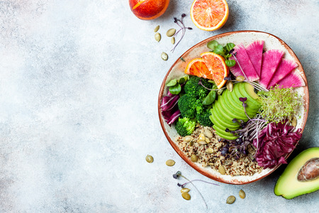 Photo for Vegan, detox Buddha bowl with quinoa, micro greens, avocado, blood orange, broccoli, watermelon radish, alfalfa seed sprouts. Top view, flat lay, copy space - Royalty Free Image