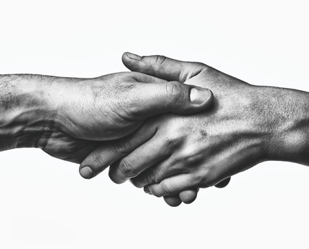 Photo for A firm handshake between the two partners. Black and white image on white  background. - Royalty Free Image