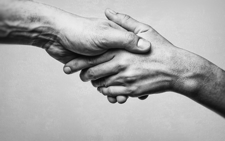 Photo for A firm handshake between two partners. Black and white image on white  background. - Royalty Free Image