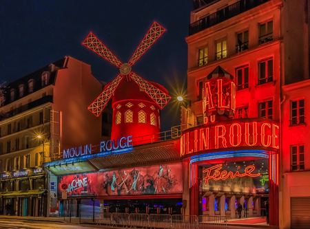 Photo for Facade of the famous Moulin Rouge cabaret in Paris, France, known as the birthplace of the can-can dance after sunset - Royalty Free Image