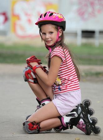Girl in helmet and roller skates