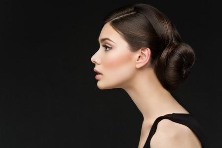 Photo pour Closeup shot of beautiful young woman profile over black background - image libre de droit