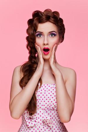 Foto de Portrait of beautiful retro style young woman with surprise expression. Isolated over pink background. - Imagen libre de derechos