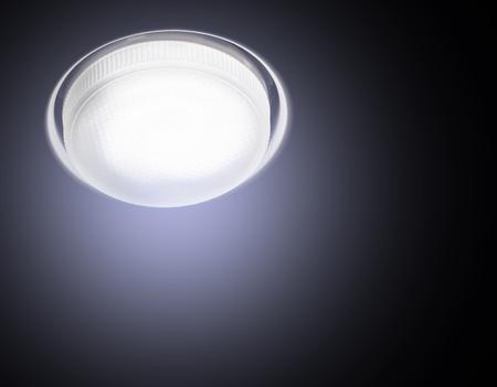 Foto de Ceiling Recessed LED lamp is lit close-up cold light on a black background. - Imagen libre de derechos