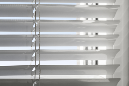 Photo for White plastic window with blinds close-up against a blue sky. - Royalty Free Image