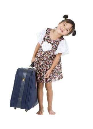 Photo for happy Asian girl carrying her heavy luggage over white background - Royalty Free Image