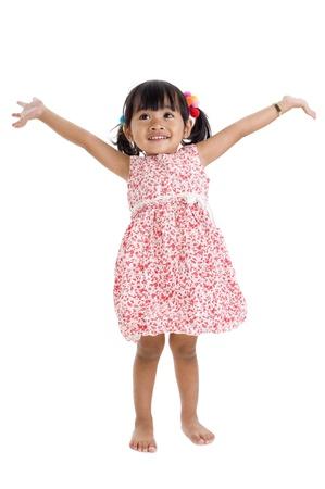 Photo pour cute little girl with arms outstretched - image libre de droit