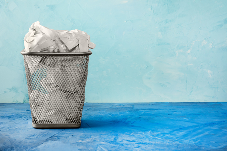 Photo pour A trash can for paper. Beautiful background with place for text. A full trash can for crumpled paper sheets. - image libre de droit