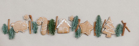 Photo for Christmas homemade gingerbread cookies in the line on craft paper background. Christmas bakery banner - Royalty Free Image