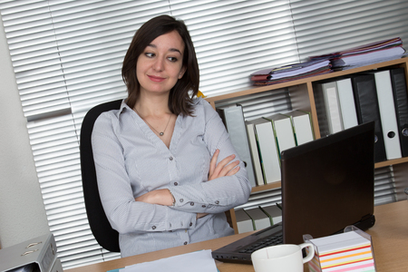 Photo pour Young attractive designer smiling at camera in creative office - image libre de droit