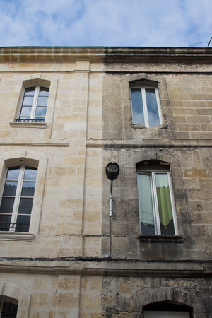 Photo pour illustration of cleaning washing wall house before and after pressure water facade in exterior - image libre de droit