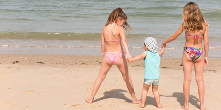 Photo for Back view of a happy children on beach - Royalty Free Image