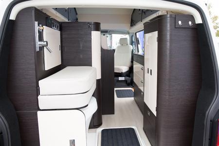 Foto de Vehicle interior view of a motorhome Modern Area Inside the Camper. Traveling with Style. - Imagen libre de derechos