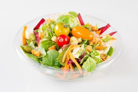 Foto de Takeaway salad on white background - Imagen libre de derechos