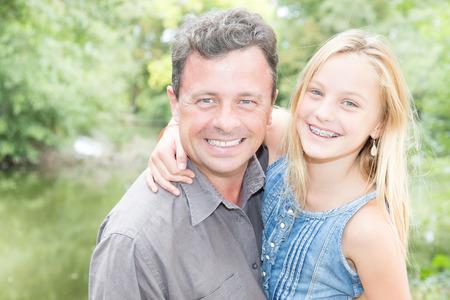 Foto de hug happy and smile father with daughter in park - Imagen libre de derechos