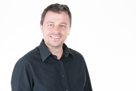 Photo pour handsome smiling man in black shirt and white background - image libre de droit