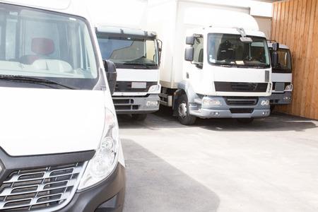 Photo pour delivery trucks ready to go to deliver the parcels - image libre de droit