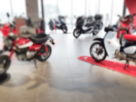 Photo pour blurry shop motorcycle with moped scooter for sale - image libre de droit