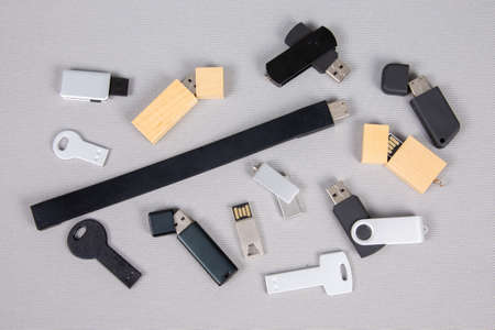 Photo pour USB flash drive memory sticks keys on white background in flat style For Advertising Branding - image libre de droit