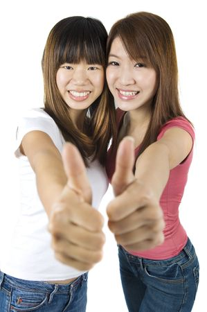 Young Asian University student giving thumbs up sign.