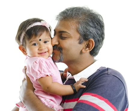 Mature Indian father kissing baby girl, isolated on white background