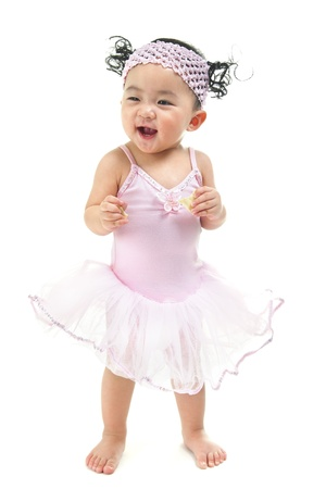 Photo for One year old Asian baby girl standing over white background - Royalty Free Image