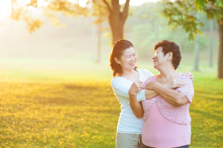 Photo for Happy Asian senior mother with her daughter at outdoor park - Royalty Free Image