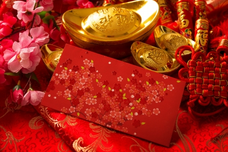 Photo for Chinese new year festival decorations, ang pow or red packet and gold ingots. - Royalty Free Image