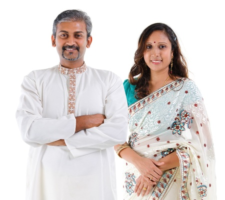Portrait of mid age beautiful Indian family in traditional costume standing isolated on white background