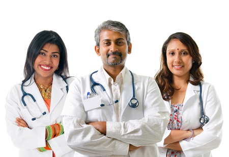 Group of Indian medical doctors, male and female standing isolated on white background.