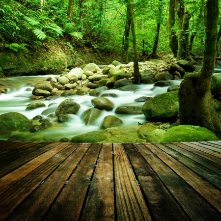 Photo for Wood floor perspective and natural mountain waterfall - Royalty Free Image
