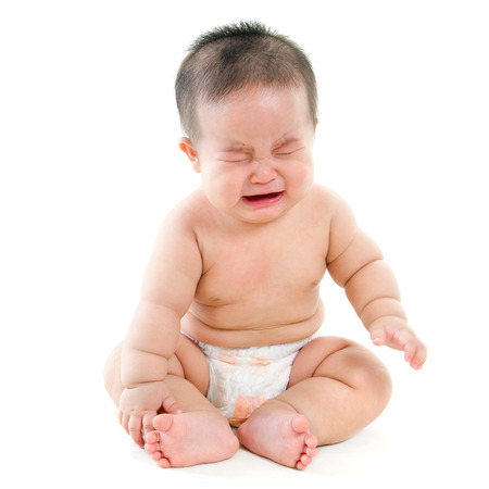 Photo pour Full body hungry Asian baby boy crying, sitting isolated on white background - image libre de droit