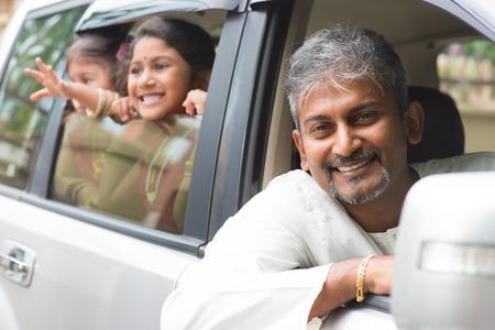 Photo pour Indian family sitting in car ready to trip. Asian parent and children lifestyle. - image libre de droit
