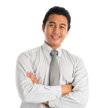 Photo for Portrait of handsome Asian young man in casual business attire, smiling confidently with arms crossed, standing isolated on white . - Royalty Free Image