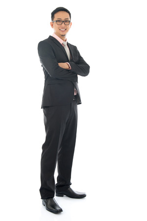 Photo for Full length confident southeast Asian business man crossed arms standing isolated on white background. - Royalty Free Image