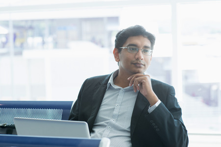 Foto per Asian Indian business man waiting his flight at airport. - Immagine Royalty Free